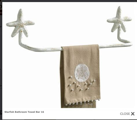 bought this primitive starfish towel bar for the guest