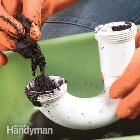 clean out sink drain how to clear clogged sink drains the family handyman