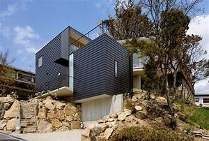 Steep Slope House With Bookshelf-Lined Interior