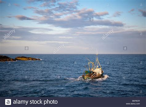 Fishing Boat Jobs Northern Ireland by Fishing Trawler Leaving Ardglass Harbour At Dusk Stock