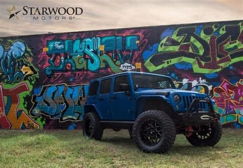 jeep blue and black 1c4hjwfg9gl219751 2016 jeep wrangler rubicon lifted blue