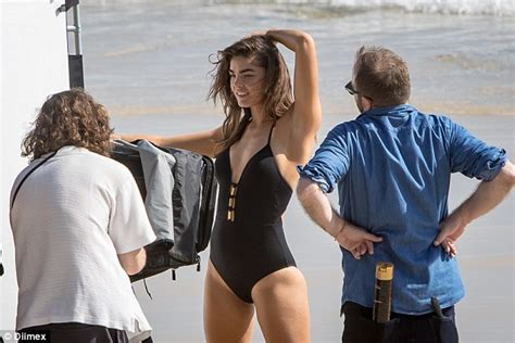 Bambi Northwood Blyth Puts Her Lithe Figure To Work In Plunging One Piece Swimsuit Daily Mail