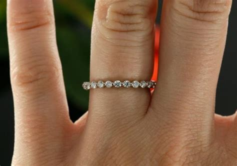 white gold eternity diamond wedding band prong set