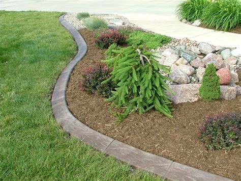mow flower bed edging poured concrete edging with a slope for easy mowing plus keeps mulch rock in place