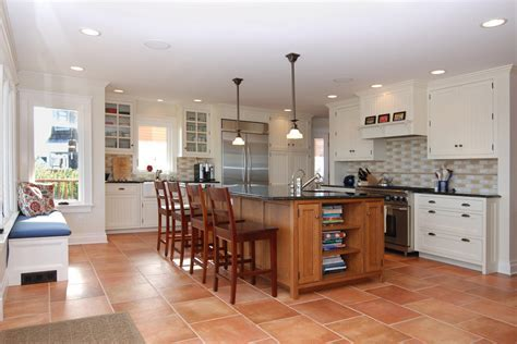 terra cotta tile Kitchen Beach with beadboard cabinets