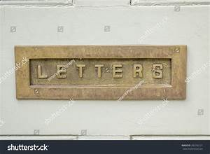 39letters39 engraved on a metal letterbox in wooden door With letters engraved in metal