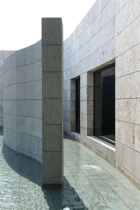 spanish home clad  dark stone assures privacy  serenity