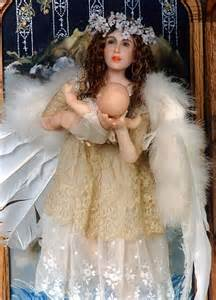 Christmas Angel Holding Baby