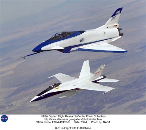 X-31 EC94-42478-8: X-31 in Flight with F-18 Chase