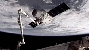 Canadarm on International Space Station captures unmanned ...
