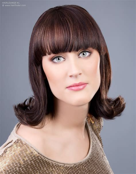60s Flip Hairstyle With An Outward Roll Of The Hair