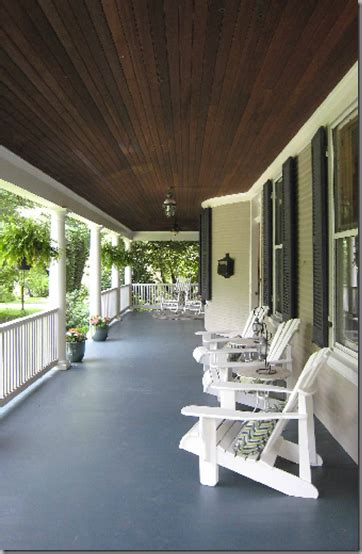 long wide porch switch dark planked ceiling  painted