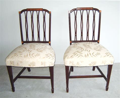 7681 pr regency upholstered carved mahogany chairs