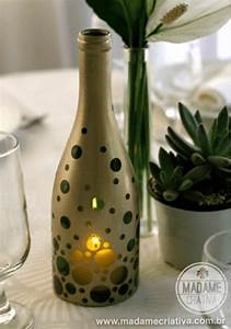 Old wine bottles 10 unique ways to upcycle into a fun diy for What kind of paint to use on kitchen cabinets for vase candle holder centerpiece