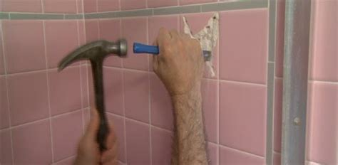 Removing Bathroom Floor Tiles by How To Remove A Bathroom Wall Tile Today S Homeowner