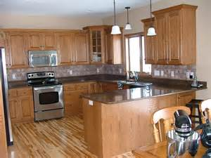 black granite counter oak hickory oak wood kitchen