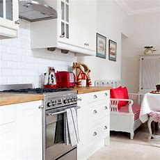 Modern White Kitchen With Red Accessories  Housetohomecouk