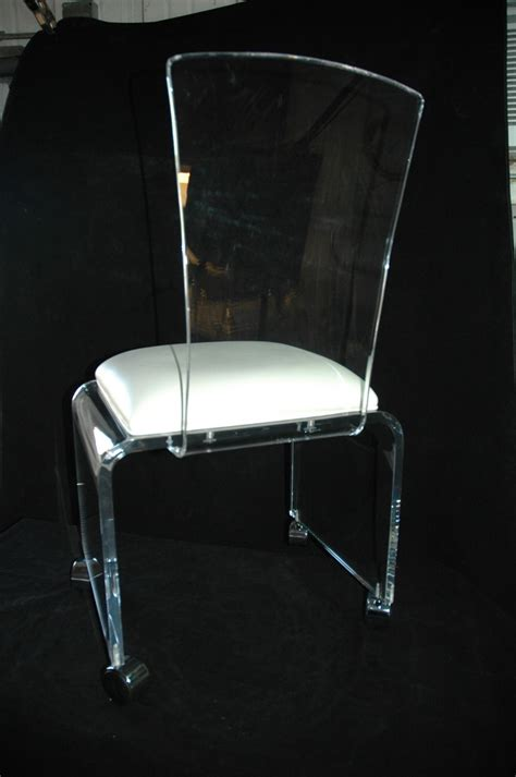 clear plastic desk chair clear acrylic desk chair in lucite desk chair with wheels