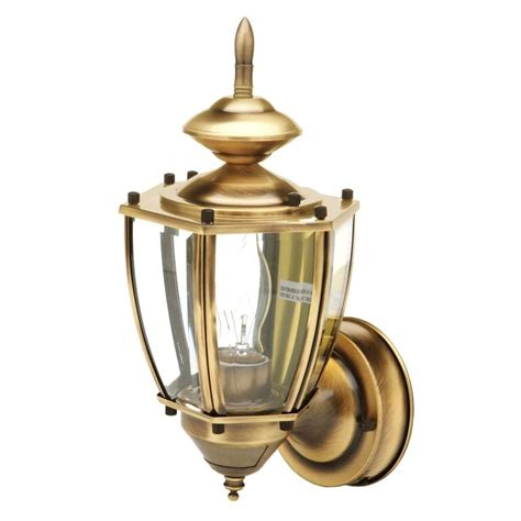cci 19 in antique brass motion activated outdoor beveled