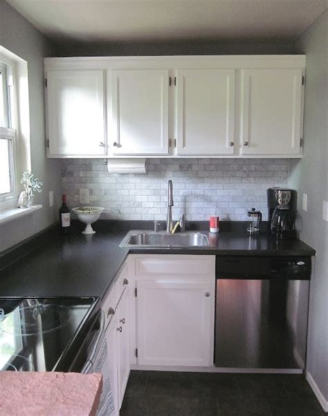 Small Ls For Kitchen Counters by Lovely Small Kitchen With Black Laminate Countertops And