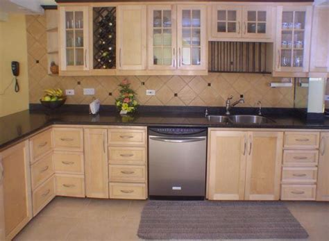 pickled oak cabinets with backsplash oak cabinets countertops and stainless steel
