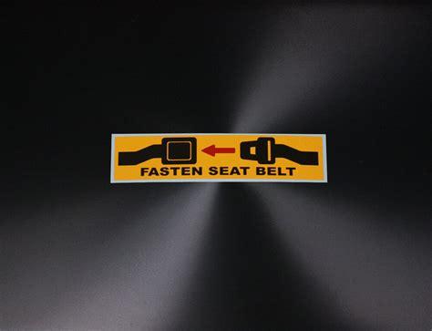 warning label fasten seat belt sign printed yellow black
