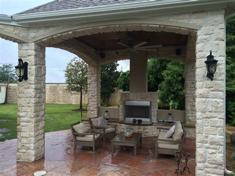 fireplace warms up houston outdoor sitting area