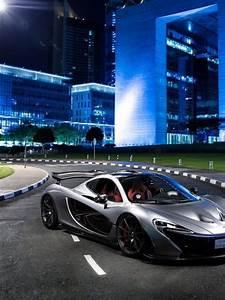 McLaren P1 silver supercar at city night 4k Ultra HD
