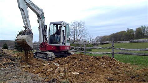 takeuchi tb mini excavator backfilling trench youtube