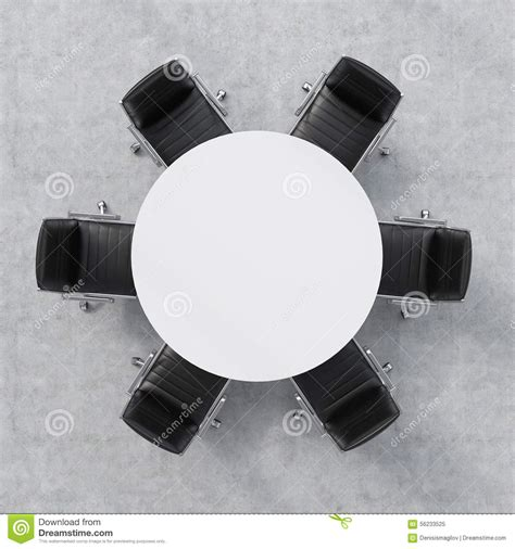 Vacant Chair by Top View Of A Conference Room A White Round Table And Six