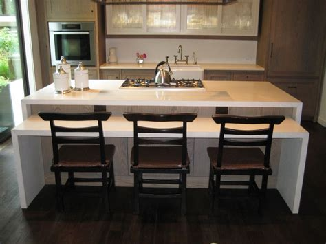 Concrete Waterfall edge kitchen island. This two tiered