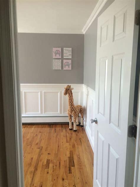nursery entry  grey walls wainscotting giraffe