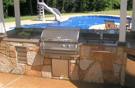 outdoor gas grill in flagstone with patio cover