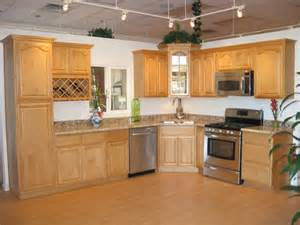 canadian maple raised cabinets with persa golden granite