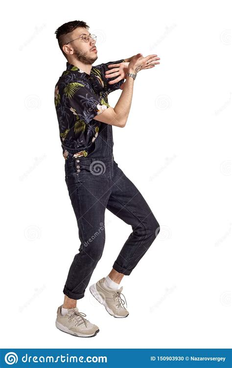 Full Length Portrait Of A Funny Guy Dancing In Studio