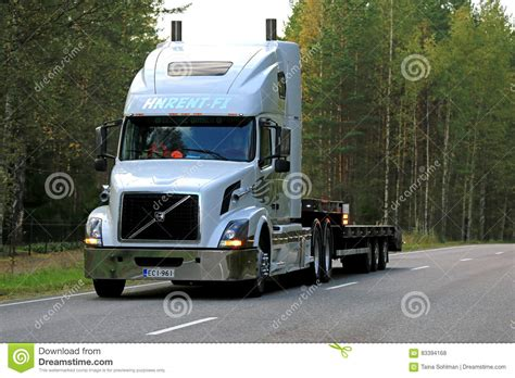volvo highway white volvo vnl 64t semi trailer on highway editorial