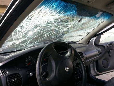 car    broken windshield   hood