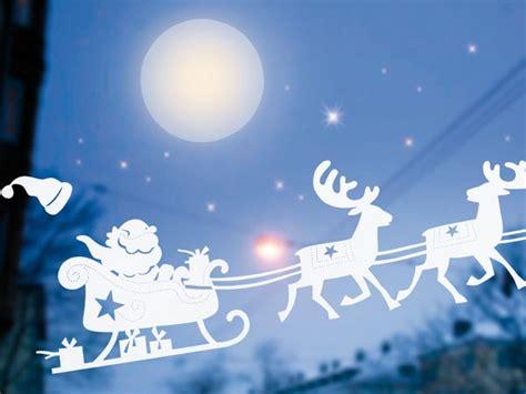 Fensterdeko Weihnachten Groß by Santa Claus Im Rentierschlitten