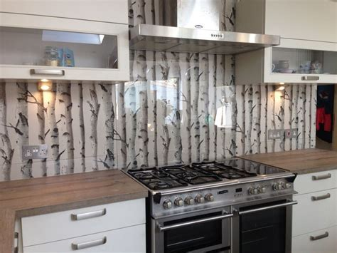 Clear glass splashback with great effect wallpaper behind