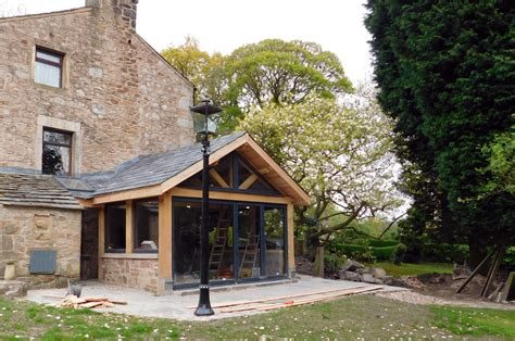 modern iron doors extension oak frame construction slate roof house