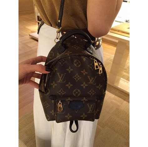 louis vuitton palm springs backpack bag reference guide spotted fashion