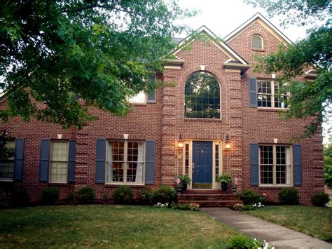 Classic Red Brick House Design With Blue Door Ideas