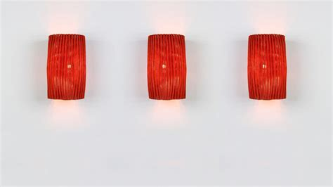 red wall lights add a splash of colour to your home