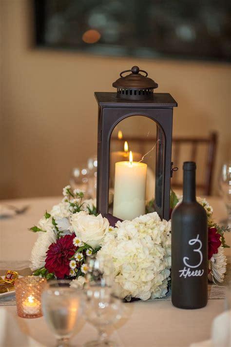 centerpieces with lanterns lantern center piece wedding wedding pinterest wedding flower and centerpieces