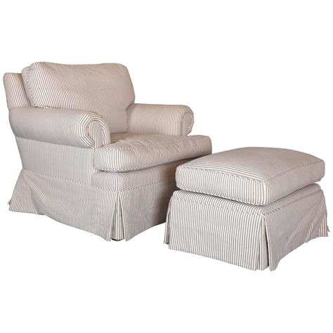 custom filled skirted club chair and ottoman in