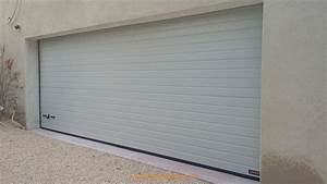installation d39une porte de garage sectionnelle motorisee With installation porte garage