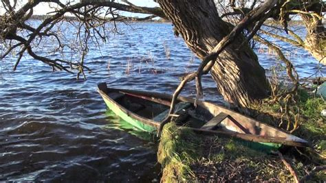 Old Wooden Boat Video by Autumn Lake Landscape With Old Wooden Boats Stock Footage