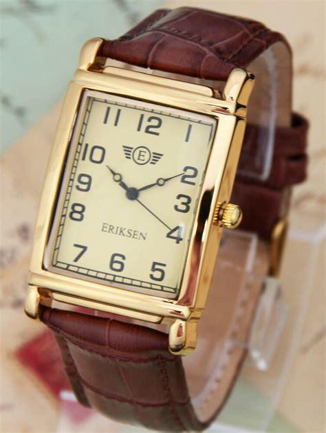 eriksen mens gold rectangular dress  leather strap