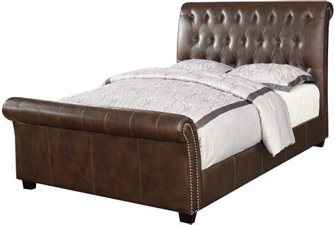 34524 upholstered king bed innsbruck ii brown king upholstered sleigh bed from