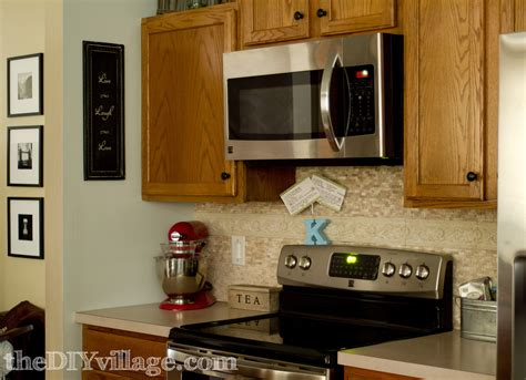 how to put up backsplash in kitchen split face travertine tile backsplash the diy village
